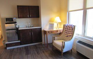 Room with chair and kitchenette