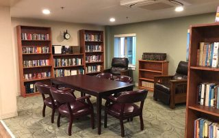 Library with leather chairs and conference table