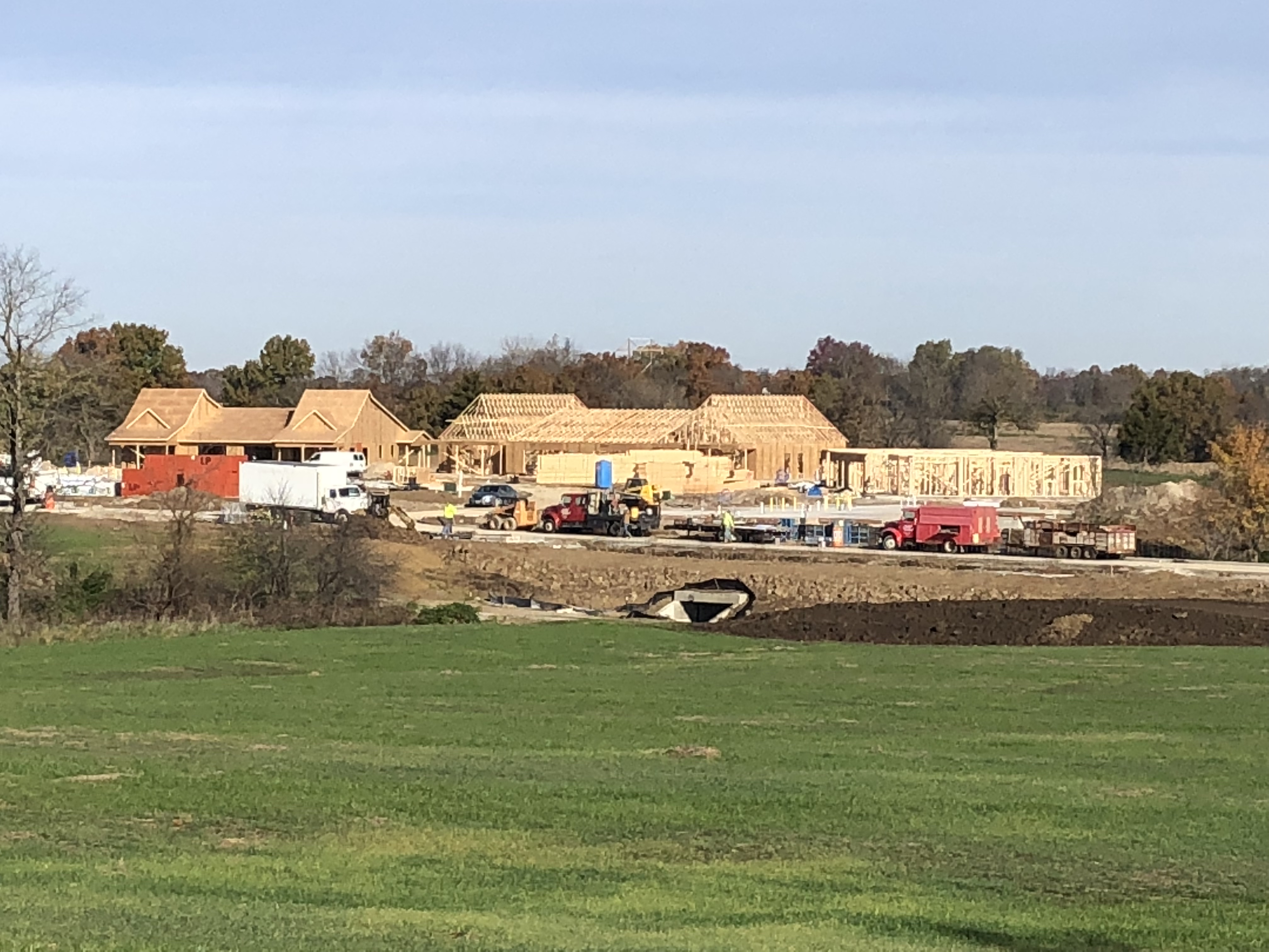 Box culvert for bridge to Ashland campus with foundation site work in background for independent living duplexes