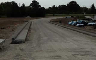 Roadway over culvert with curb and gutters