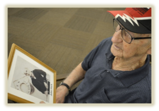 elderly man looking at photo